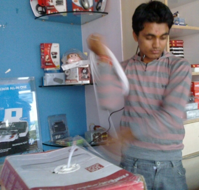 Rakesh spinning a coil of CAT-5 around his arm
