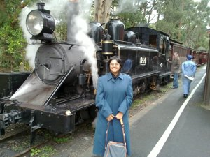 Sumana in front of a steam engine