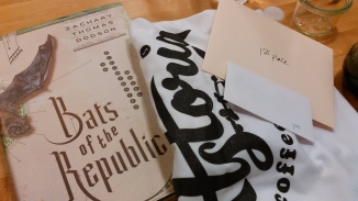 my winnings - a book, a t-shirt, and gift certificates to Astoria Coffee and Astoria Bookshop